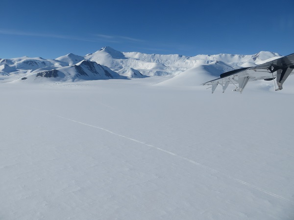 The open field of snow and the ski-marks from the Otter