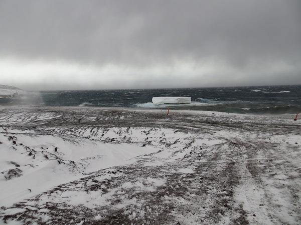 The snow stopped but the wind didn't. An iceberg got lodged near the shore.