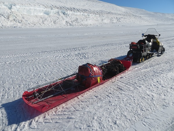 The sled Lee towed on the back of his snowmobile