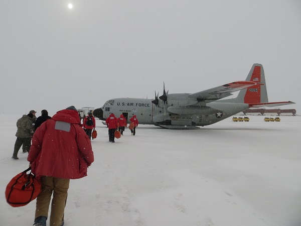 Lee, in the foreground, and everyone else boarding the LC-130 for the flight north to Christchurch, New Zealand. You can see the snow, but the plane was still able to take off with no difficulty.