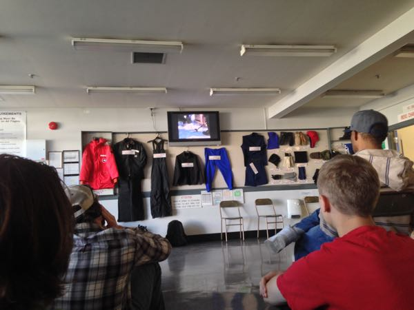 Watching training videos with the wall of ECW clothing in the background