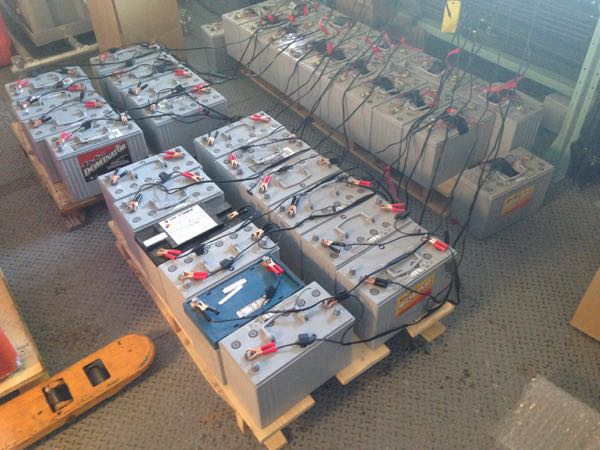 Charging all of the batteries before we pack them into the power boxes
