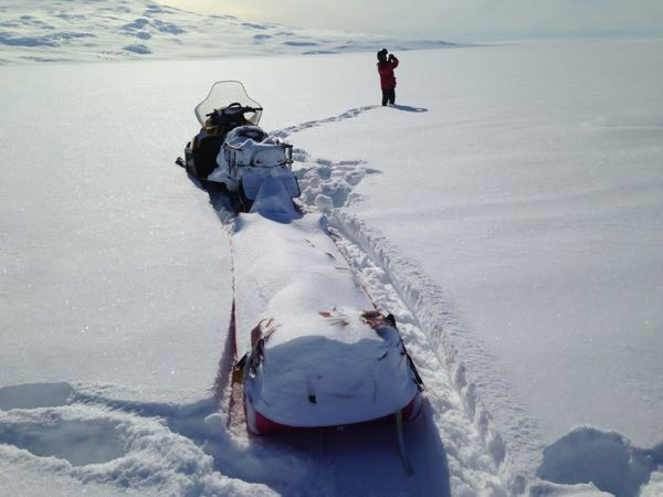 We arrived at the site and our sled was covered with snow