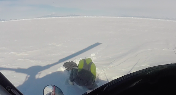 Dave trying to get the snowmobile cover off the sea ice near McMurdo