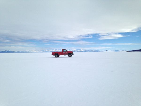 The pickup truck parked on the ice shelf near the Willie Field airfield