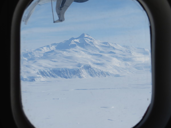 A prominent peak in the Transantarctic Mountains, viewed from the window.