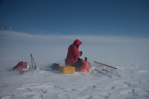 Mark snapped a picture of me radio-ing in to McMurdo. Note how the blowing snow has increased.