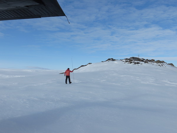 Paul checked for crevasses along the path from the plane to the AWS (upper right).